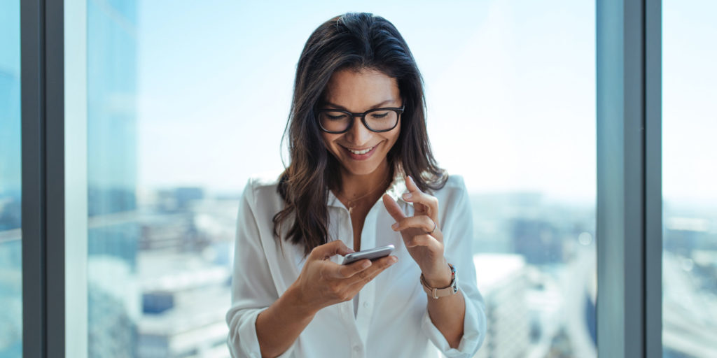Investor looking at phone